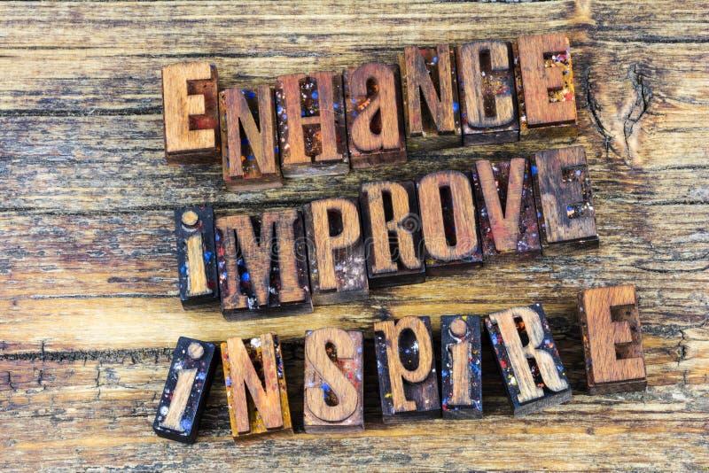 Enhance verbessern anspornen Briefbeschwerer stockbilder