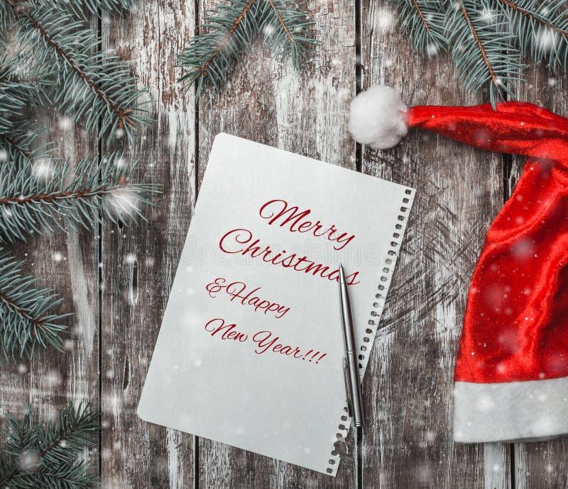 Enhorabuena en estilo rústico con un folleto donde usted puede dejar un mensaje para Papá Noel imagenes de archivo