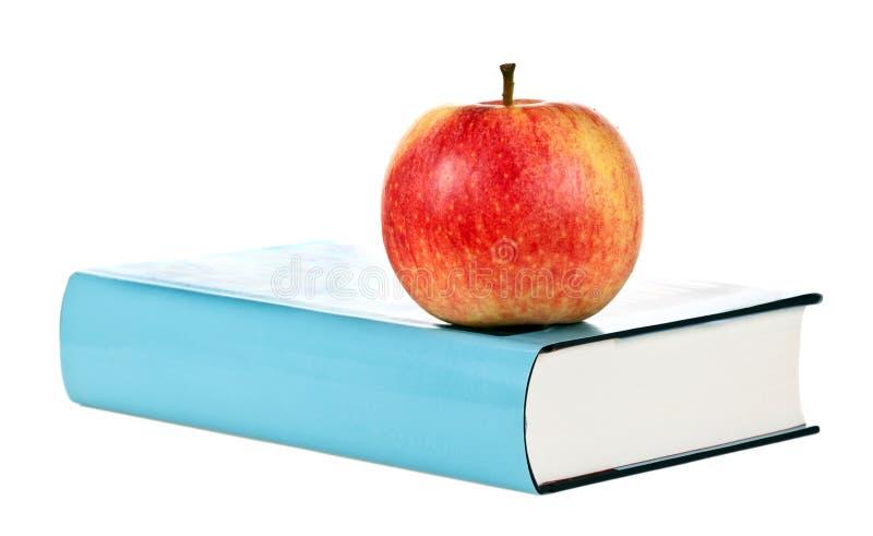 Enig boek met appel royalty-vrije stock afbeeldingen