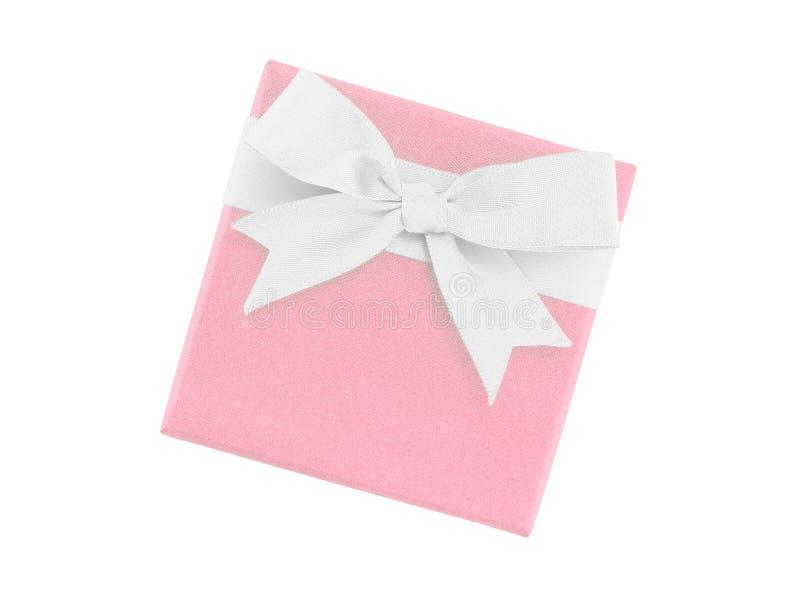 Enige gesloten de giftdoos van de pastelkleur roze kleur met witte die lintboog op witte achtergrond wordt geïsoleerd stock foto's