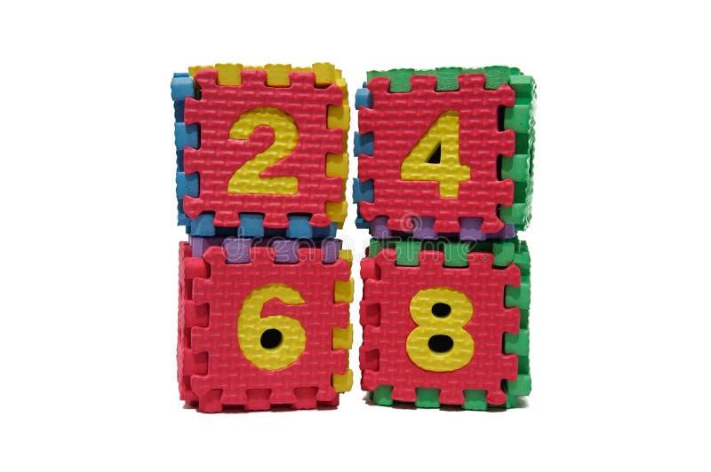 Enigma colorido do cubo de números uniformes fotos de stock royalty free