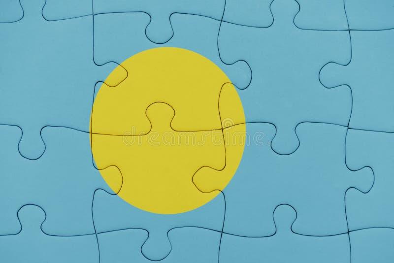 Enigma com a bandeira nacional de Palau fotos de stock