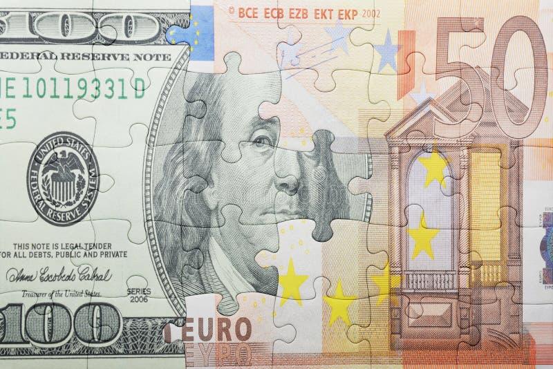 Enigma com o dólar e a euro- cédula fotos de stock royalty free