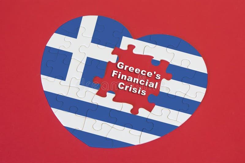Enigma de serra de vaivém da bandeira de Grécia da forma do coração com uma palavra escrita Grécia fotos de stock royalty free