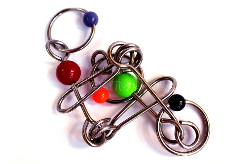 Enigma, fundo, branco, metal, isolado, brinquedo, aço, objeto, jogo, prata, metálica, crianças, modernas, molde, preto, close up, fotos de stock royalty free