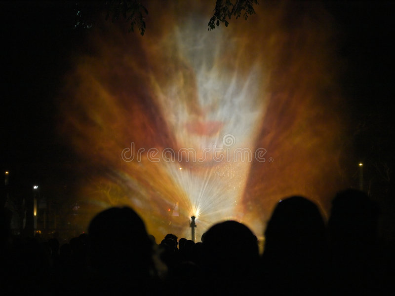 Enigmatic. Projection of pictures on a water curtain created by a fountain, to the symphonic strains of Mussorgsky's Pictures at an Exhibition, as part of stock image