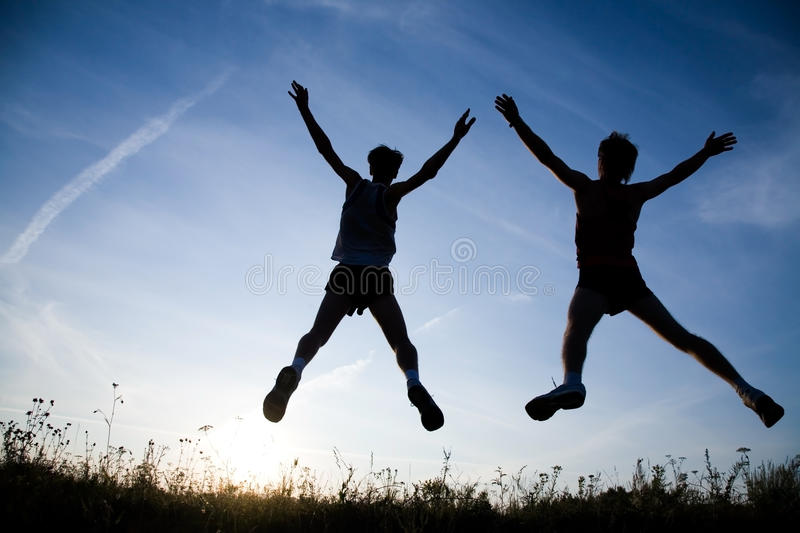 Download Enjoy stock photo. Image of jump, silhouette, dark, dawn - 11704304