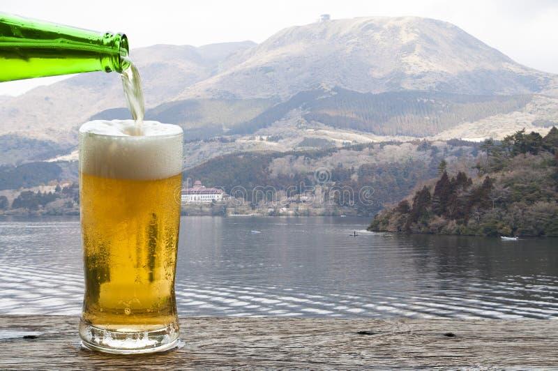 Enjoy beer with mountain landscape beside Lake Ashi Hakone, Japan. stock photo