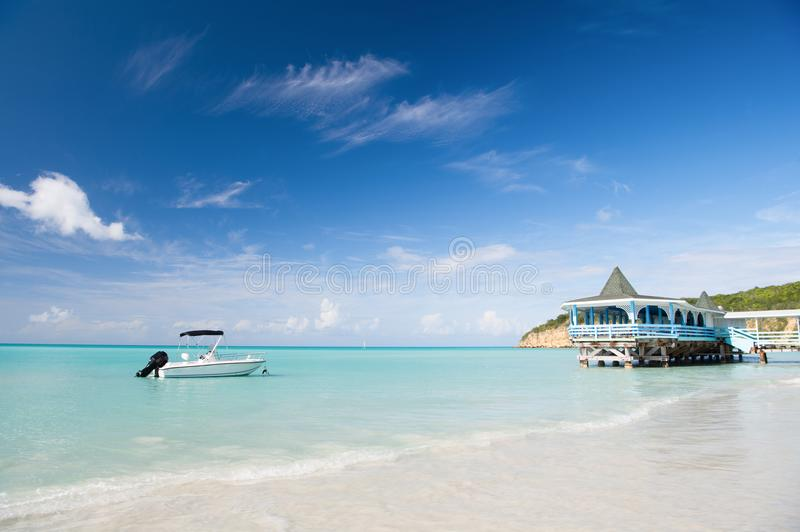 Enjoy benefits being beside sea. Sea turquoise water bungalow and ship near beach. Vacation sea sand beach tropical stock image