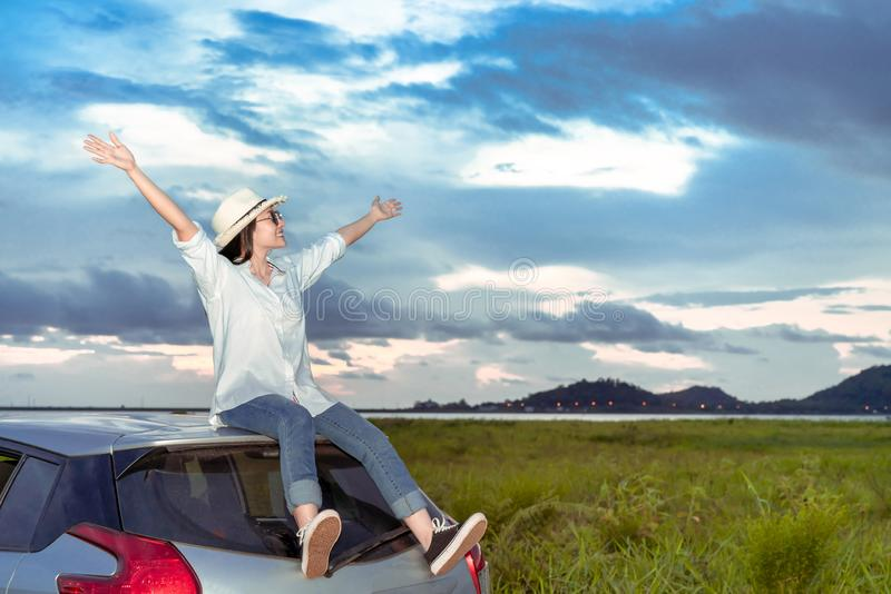 Enjoy Car travel of woman driving travel raised arms fresh air nature. At lake river in summer vacation road trip on holidays to destination, Traveler stock photos