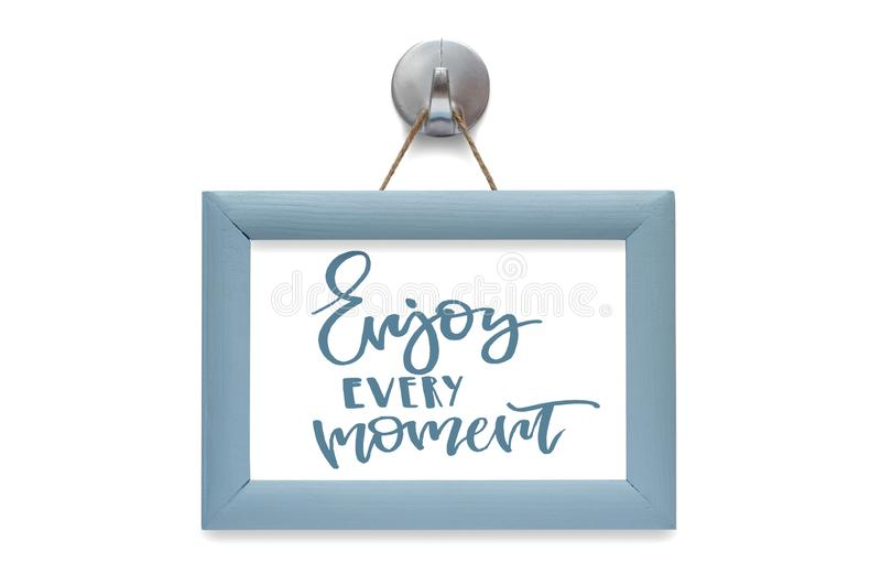 Enjoy every moment. Modern calligraphy. Motivational quote. Blue stock photos