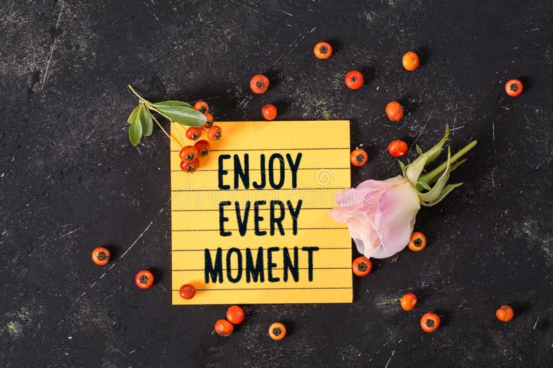 Enjoy every moment text in memo stock image