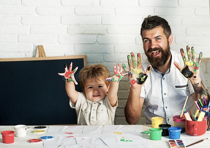 Enjoy with father. A happy family. Drawing with finger paints. Development and art. A good kindergarten. Professional stock photography