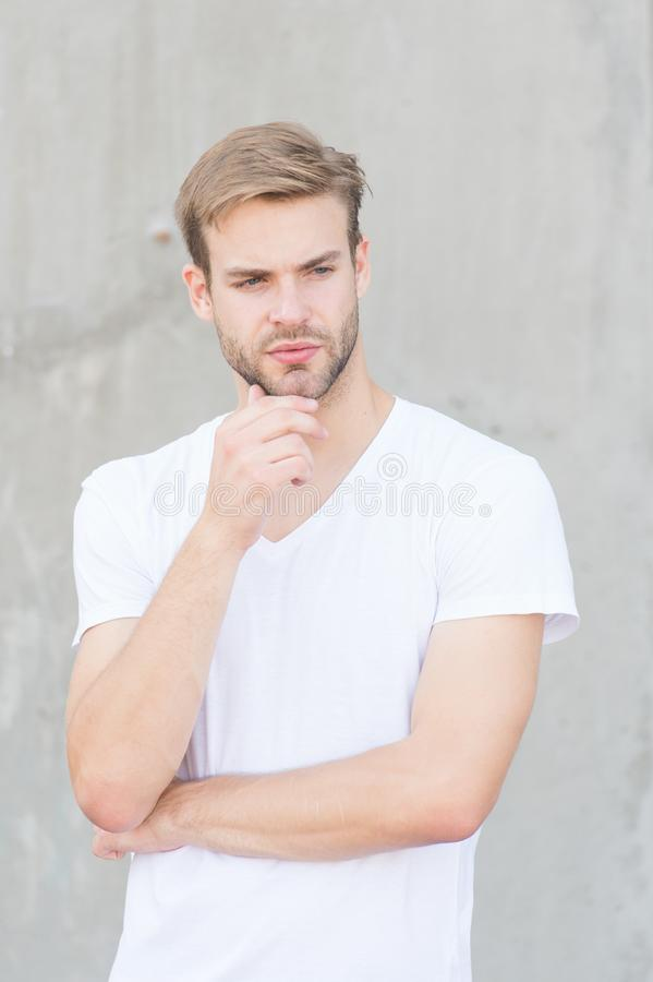 Enjoy his style. young sexy guy gray background. unshaved macho man. summer male fashion. student unshaven face stylish royalty free stock image