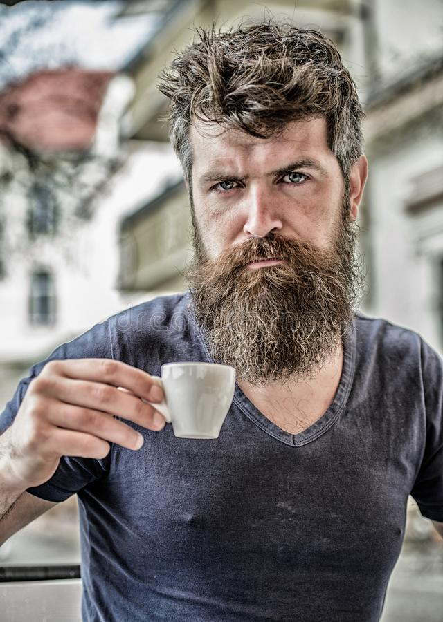 Enjoy hot drink. Hipster drinking fresh brewed coffee. Bearded guy consume caffeine. Espresso arabica only. Coffee break. Concept. Guy relaxing espresso. Man royalty free stock photography