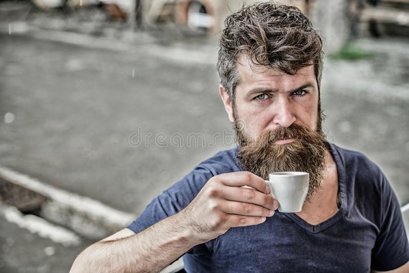 Enjoy hot drink. Hipster drinking fresh brewed coffee. Bearded guy consume caffeine. Espresso arabica only. Guy relaxing. Espresso. Man with beard and mustache royalty free stock images