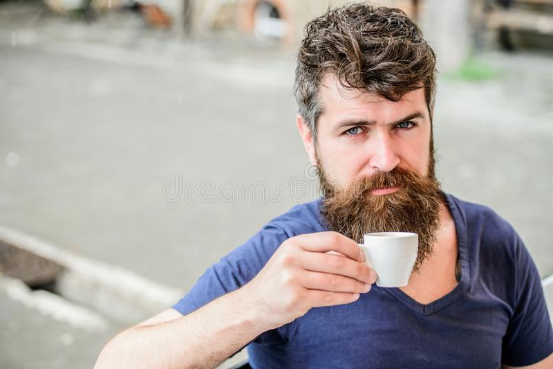 Enjoy hot drink. Hipster drinking fresh brewed coffee. Bearded guy consume caffeine. Espresso arabica only. Guy relaxing. Espresso. Man with beard and mustache royalty free stock photos