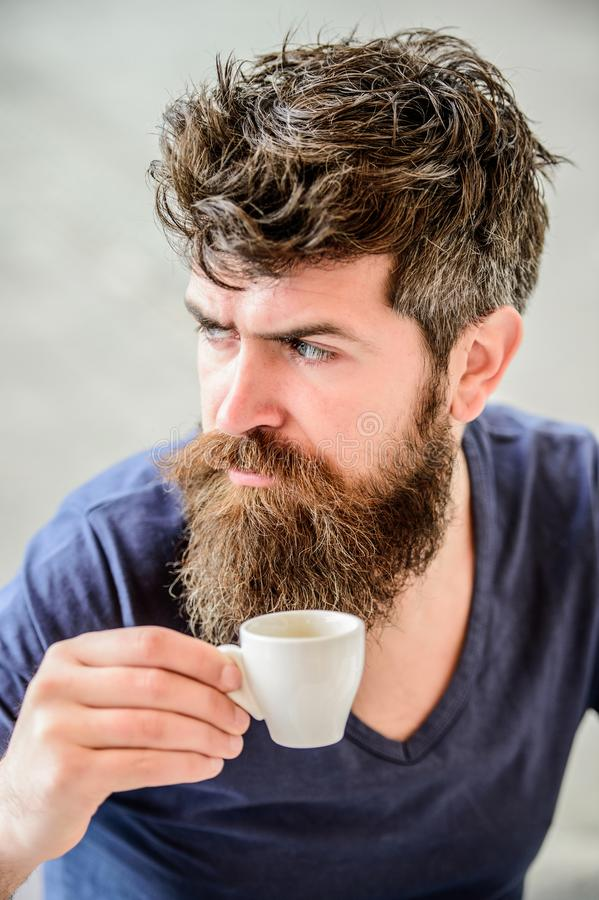 Enjoy hot drink. Hipster drinking fresh brewed coffee. Man with beard and mustache and espresso cup. Bearded guy consume. Caffeine. Espresso arabica only stock photo