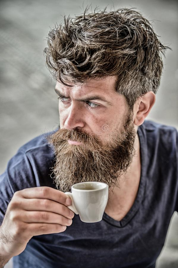 Enjoy hot drink. Hipster drinking fresh brewed coffee. Man with beard and mustache and espresso cup. Bearded guy consume. Caffeine. Espresso arabica only royalty free stock photos