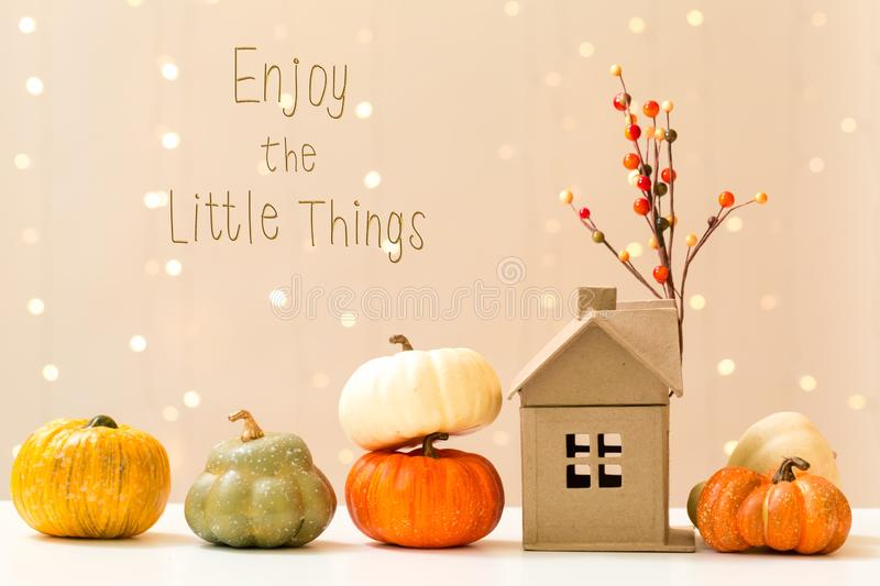 Enjoy the little things message with pumpkins with a house royalty free stock photos