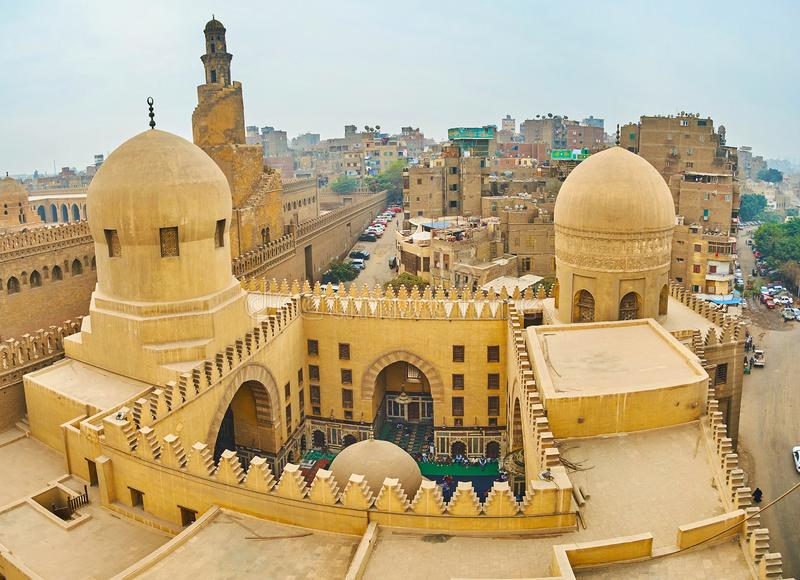 Amir Sarghatmish mosque from its minaret, Cairo, Egypt. Enjoy the medieval architeqture of Amir Sarghatmish mosque from its tall minaret, overlooking the carved stock photography