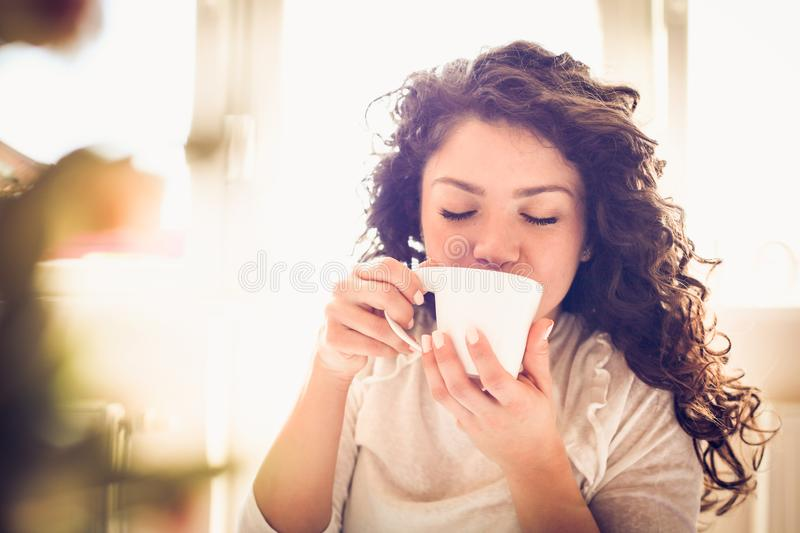 Enjoy in morning coffee. Young woman. stock photography