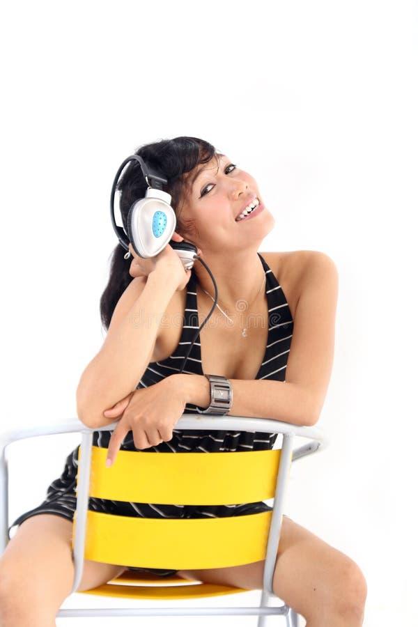 Download Enjoy music stock photo. Image of holding, earphones - 12325540