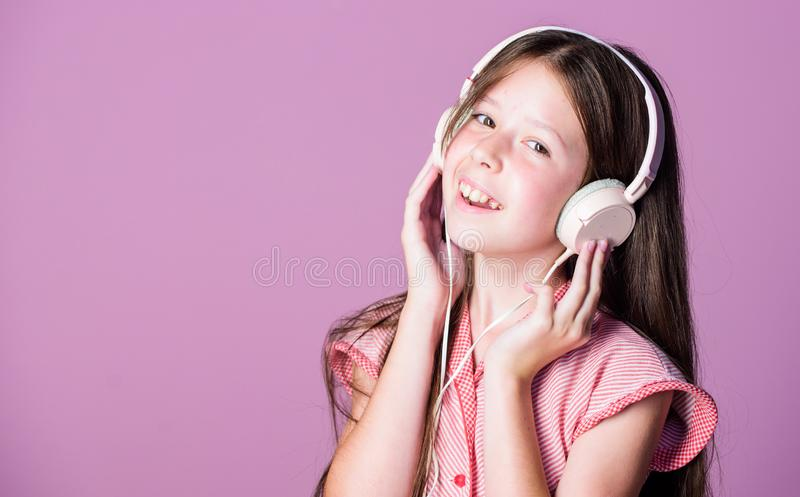 Enjoy music. child study online. E learning with ebook. self education. Mp3 player. small girl pupil in headphones. home. Schooling. girl listen to music. Audio royalty free stock images