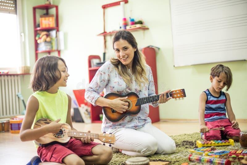 We enjoy in music. Children in preschool stock image