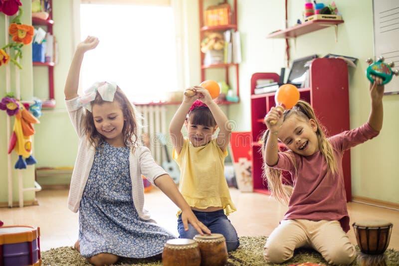 Enjoy music. Children in preschool royalty free stock photos