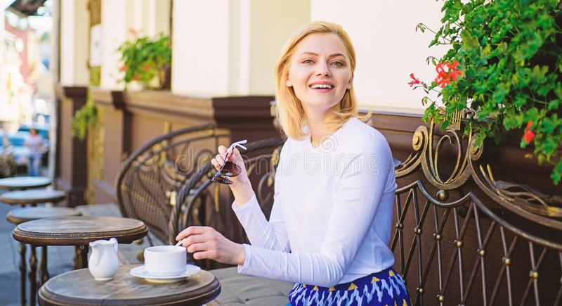 Enjoy my coffee. Mug of good coffee in morning gives me energy charge. Girl drink coffee every morning at same place as stock image