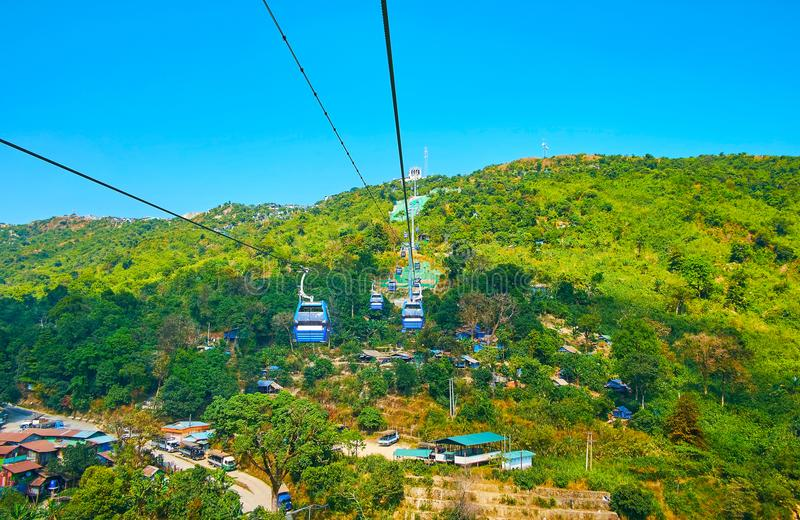 Travel on first Burmese cable car, Kyaiktiyo, Myanmar. Enjoy the nice views, wile traveling in first Burmese cable car, connecting Yathetaung township and the stock image