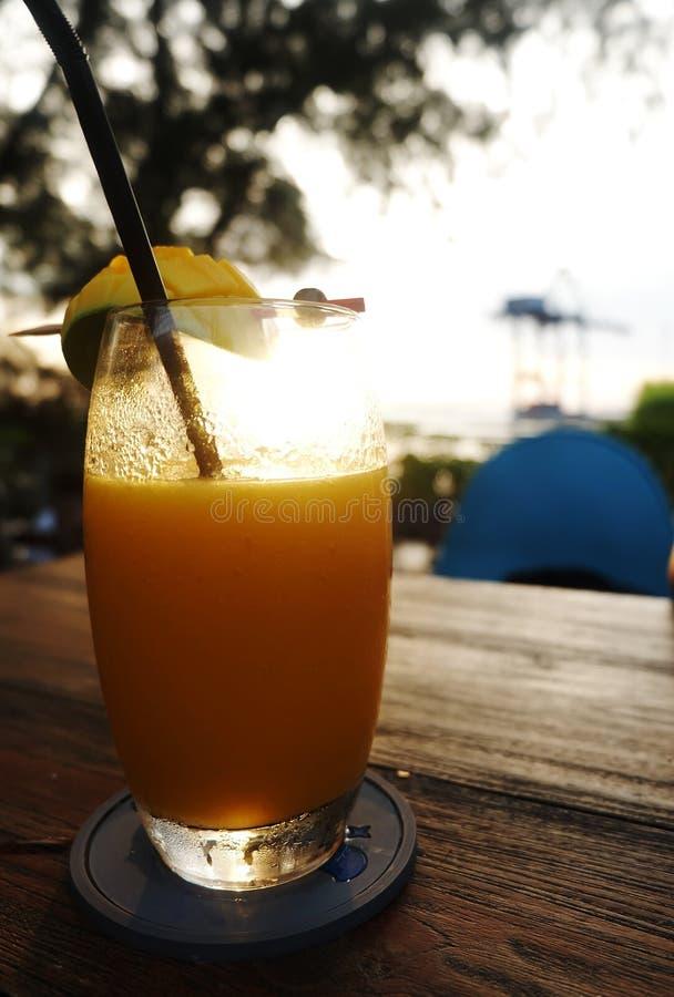 Enjoy the orange juice moment while sunset royalty free stock photo