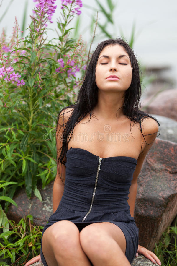 Enjoy the rain. Girl with eyes closed enjoying the rain royalty free stock photography
