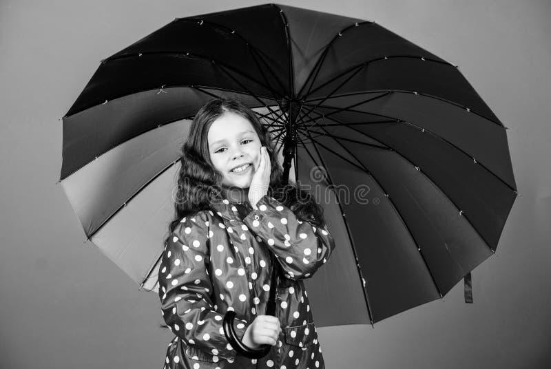 Enjoy rain concept. Kid girl happy hold colorful rainbow umbrella. Rainy weather with proper garments. Bright umbrella. Be rainbow in someones cloud. Rainy day stock photos
