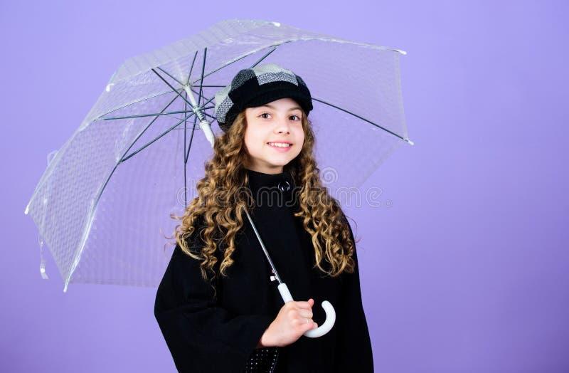 Enjoy rainy weather with proper garments. Waterproof accessories make rainy day fun. Fall season. Enjoy rain concept. Kids fashion trend. Love rainy days. Kid stock images