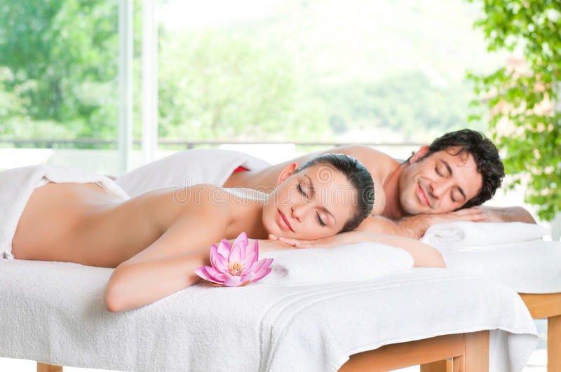 Enjoy the relax at spa. Beautiful couple relaxing together at spa centre after a beauty treatment
