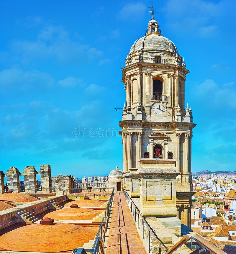 The roof walk on Malaga Cathedral, Spain. Enjoy the roof walk on Malaga Cathedral and explore its tall historical bell tower with slender columns and carved stock image