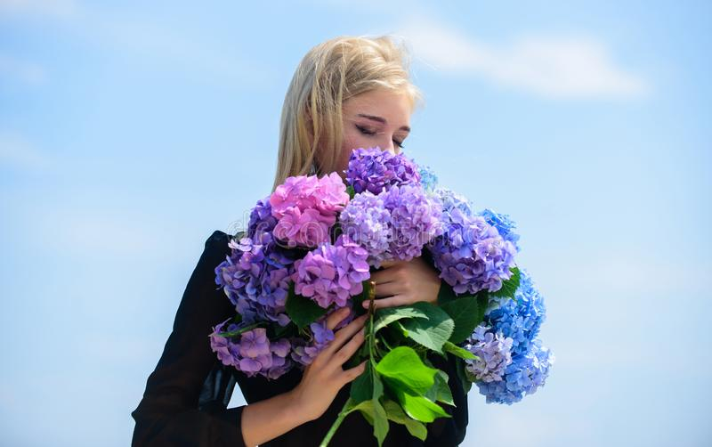 Enjoy spring without allergy. Gentle flower for delicate woman. Girl tender blonde hold hydrangea flowers bouquet. Allergy free life. Stop allergy blooming royalty free stock photos