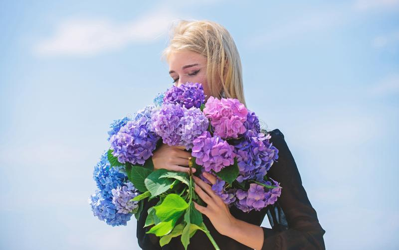 Enjoy spring without allergy. Gentle flower for delicate woman. Girl tender blonde hold hydrangea flowers bouquet. Allergy free life. Stop allergy blooming royalty free stock photography