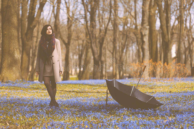 Enjoy the spring. Beautiful girl enjoys spring time in the park stock images