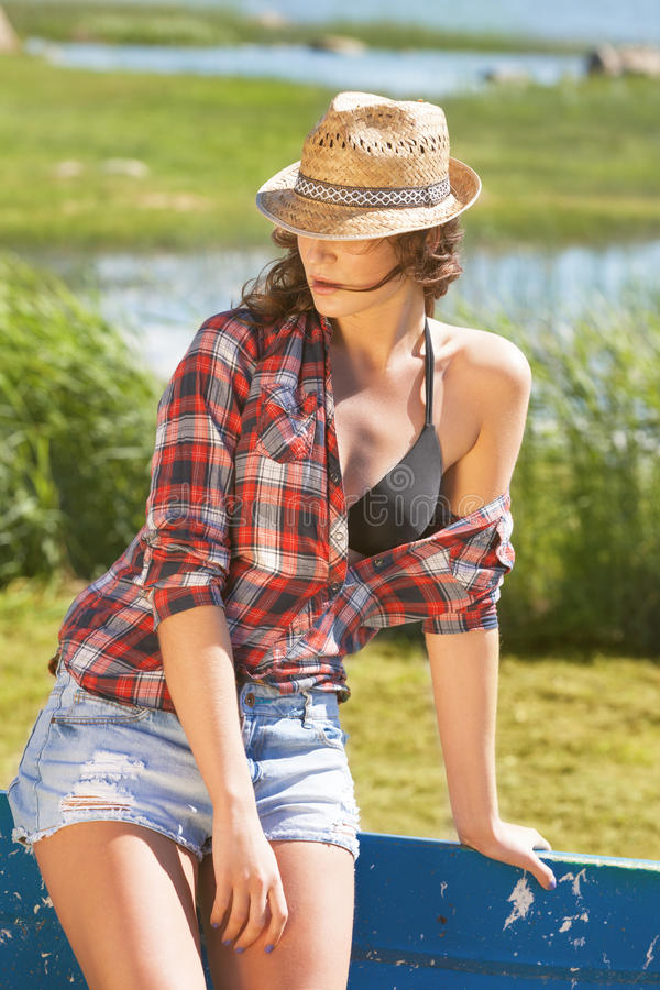 Enjoy the summer. Attractive woman enjoying summer on the country side royalty free stock photography