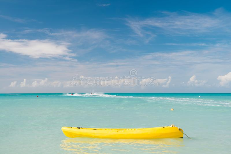 Enjoy summer. Spend vacation exciting occupation st.johns antigua. Sea turquoise water yellow canoe near beach. Extreme stock photos