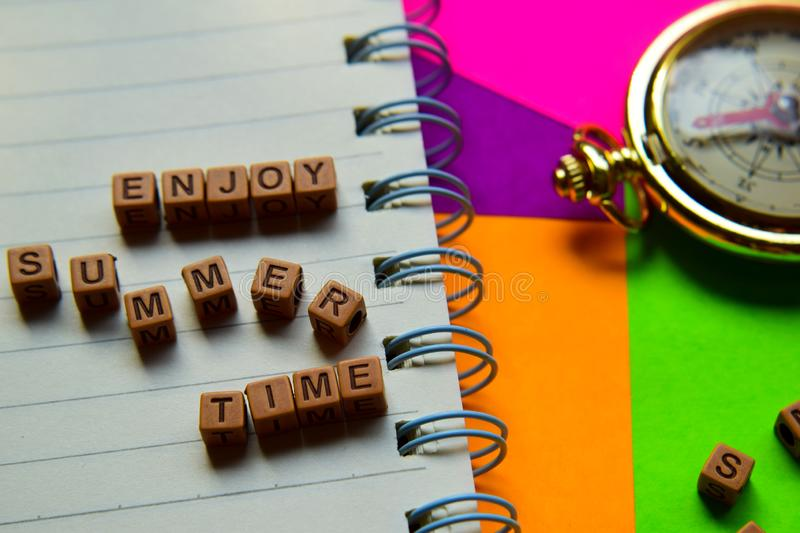 Enjoy summer time message written on wooden blocks. Vacation and travel concepts. Cross processed image royalty free stock image
