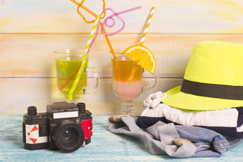 Exotic drinks with traveler's outfit stock photos