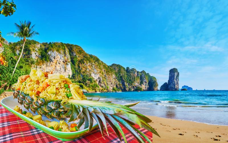 Thai pineapple fried rice on Monkey beach, Ao Nang, Krabi, Thailand. Enjoy tasty Thai pineapple fried rice with nuts and vegetables in cafe on Ao Nang coast royalty free stock image