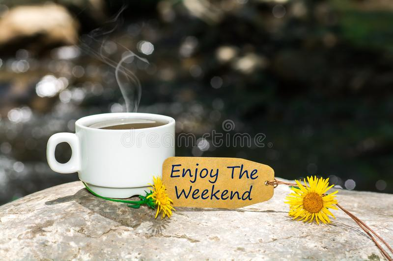 Enjoy the weekend text with coffee cup stock images