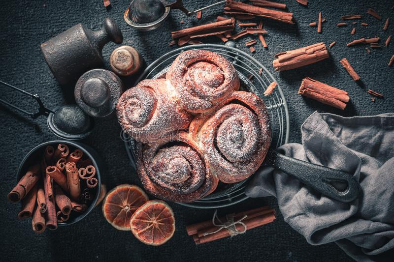 Enjoy your cinnamon rolls as swedish christmas dessert. On dark table royalty free stock photography