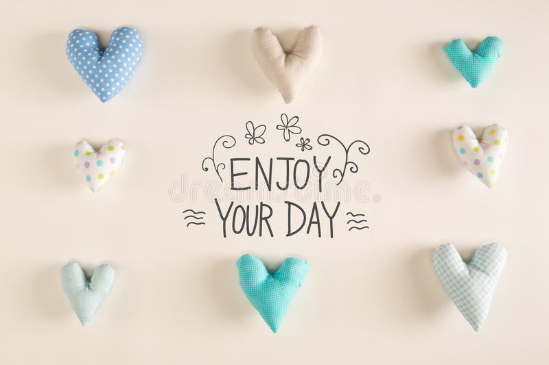 Elegant Download Enjoy Your Day Message With Blue Heart Cushions Stock Photo    Image Of Many,