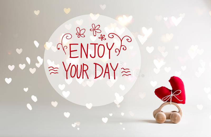 Marvelous Download Enjoy Your Day Message With Toy Car Carrying A Heart Stock Image    Image Of